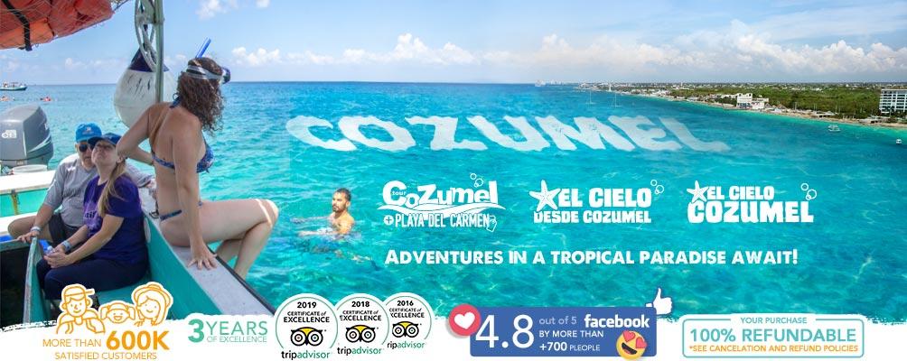 woman swiming in the sea of cozumel reef